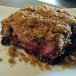 Saskatoon Berry Cream Cheese Crumb Cake Recipe - With a crumb crust, a cream cheese crumble topping, and a saskatoon berry filling, this dessert is a delicious cross between a crisp and a crumb cake.