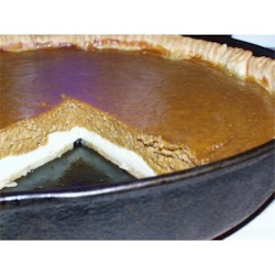 Paradise Pumpkin Pie I Recipe - This easy-to-make pumpkin pie has a surprise cream cheese bottom. Softened cream cheese is sweetened with sugar and a bit of vanilla. The tasty filling is made from pumpkin puree, cinnamon, ginger, nutmeg, evaporated milk, sugar, and eggs. After an hour in the oven, the pie is set and delicious.