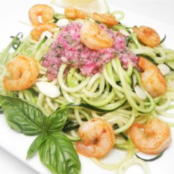 "Grilled Shrimp over Zucchini Noodles Recipe - Zucchini noodles (also known as ""zoodles"") in a homemade lemon basil dressing are topped with shrimp in this quick and easy paleo-friendly, gluten-free meal."