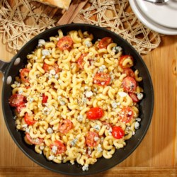 Quick and Simple Elbows with Spicy Curry & Gorgonzola Recipe - Elbow pasta seasoned with spicy curry is tossed with crumbled Gorgonzola and Parmigiano-Reggiano cheeses and cherry tomatoes.