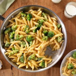 Creamy One Pan Broccoli Cheddar Penne Recipe - Penne pasta and chopped broccoli in a creamy sauce is served with lots of shredded Cheddar cheese for this quick and delicious weeknight dinner.