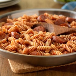 Mike's One Pan Rotini with Sausage and Spicy Marinara Recipe - Sausage and spicy marinara sauce bring rich and zesty flavors to this quick and easy rotini pasta dish.