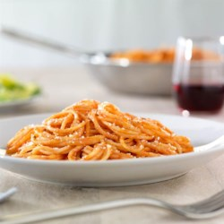 Simple Spaghetti with Creamy Marinara Sauce Recipe - This spaghetti dinner with a creamy marinara sauce, fresh basil, and grated Parmesan cheese is ready to serve in about 15 minutes.