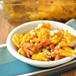 Buffalo Chicken Macaroni and Cheese Recipe - Chicken marinated in ranch dressing and hot sauce is layered with celery and blue cheese is this decadent buffalo chicken macaroni and cheese dish.