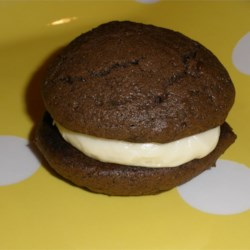 Southern Moon Pies Recipe - These pies are homemade cookie sandwiches that are filled with a dreamy marshmallow concoction. First you whip up the batter for the cookies that 's made with evaporated milk, butter, sugar, cocoa and a few other delicious ingredients. Drop the dough onto cookie sheets, bake, and slather the cookies with the marshmallow mixture.