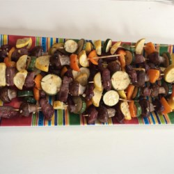 "Firecracker Kabobs Recipe - Beef is marinated in a maple syrup-lime juice marinade and grilled with vegetables in this ""Firecracker Kabobs"" recipe that is great for the Fourth of July."