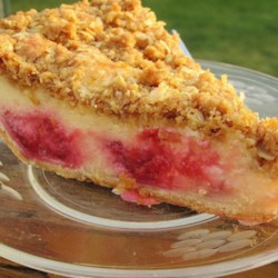 Raspberry Sour Cream Pie Recipe - A must-have for the raspberry lover. I get rave reviews every time I serve this. And because you can use frozen or fresh raspberries, you can enjoy it all year! This recipe makes 2 pies.