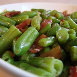 Snappy Green Beans Recipe - Green beans sauteed with onions and vinegar, topped with crumbled bacon.