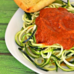"Zucchini Spaghetti alla Marinara Recipe - Zucchini spaghetti, also known as ""zoodles"", is tossed in a fresh marinara sauce creating a quick and easy, gluten-free noodle dish."