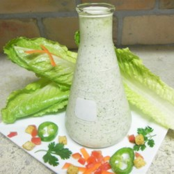 Creamy Cilantro Lime Dressing Recipe - Quick and easy, creamy cilantro-lime dressing is great on a green salad, taco salad, or even as a dipping sauce for chicken.