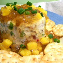 Mango Chutney Cheese Ball Recipe - Mango chutney tops off this magnificent cheese ball with bacon, onion and golden raisins. Simple, simple recipe and the dish is emptied EVERY time!!