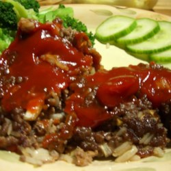Wonderful Meatloaf Recipe - Ground beef is mixed with cooked rice, onion, brown sugar, and ketchup, and baked in a loaf pan for 30 minutes. It is then topped with additional ketchup and baked for 15 minutes more.