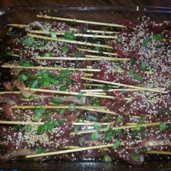 Asian Steak Skewers Recipe - Sesame oil and freshly grated ginger give these Asian-inspired steak kabobs and extra zing with every bite.