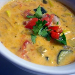 Mexican Zucchini Cheese Soup Recipe - We can't wait to make this delicious, slightly spicy soup every summer when zucchini and squash are plentiful in our garden. We like to serve this soup with warm tortillas.