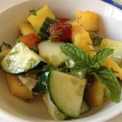 Pineapple Cucumber Salad Recipe - Fresh pineapple, cucumber, and herbs with a chili-lime dressing combine in a light, refreshing salad.