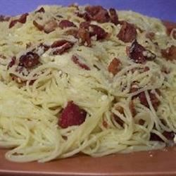 Bacon Spaghetti Recipe - Fragrant and hearty, this quick and easy spaghetti dish is a simple matter of crumbled bacon, minced garlic, olive oil, salt and pepper, grated Parmesan and hot noodles!