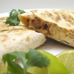 Grilled Chicken Quesadillas Recipe - This recipe is a delicious snap. The meat is coated with adobo seasoning, grilled, and cut into bite-sized pieces. Then a tortilla is layered with cheese, chile peppers, chicken, and olives.