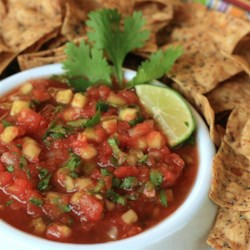 Dill Pickle Salsa Recipe - As implied by the title, this salsa recipe has the surprise addition of dill pickle flavor through addition of diced pickle and pickle 'juice.'
