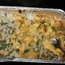 Chicken, Rice, and Green Bean Casserole Recipe - Chicken, green beans, and wild rice are baked with cream of mushroom soup and mayonnaise in this comfort food recipe.