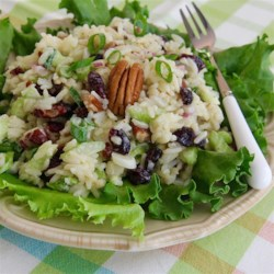 Fruity Rice Salad and Orange Vinaigrette Recipe - This versatile fruity rice salad uses celery, dried cranberries, toasted pecans, and onions with white rice, but feel free to substitute your favorite dried fruits and nuts.