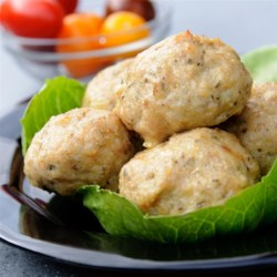 Cheesy Chicken Meatballs Recipe - Garlic cream cheese adds great flavor to these zesty chicken meatballs, while ensuring that they'll be light, moist, and delicious.