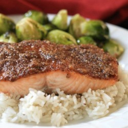 Paleo Pecan-Maple Salmon Recipe - Baked salmon coated in a crunchy pecan-maple topping is a very tasty dinner that fits into a paleo-, gluten-free, and dairy-free lifestyle.