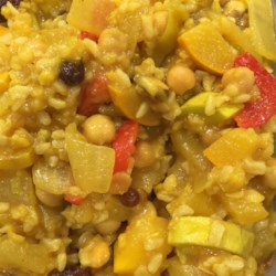 Mediterranean Yellow Rice and Vegetables Recipe - A colorful medley of instant brown rice with zucchini, pineapple, red and yellow peppers is cooked in a sweet and savory broth.