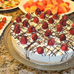 Laurie's Amaretto Mousse Cheesecake Recipe - A simple yet stylish no-bake cheesecake. Garnish with cherries and chocolate sauce for breathtaking results. This cake is mmmm... good