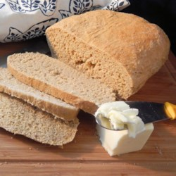 Hot Water Cornmeal Bread Recipe - If you like to bake in bulk, this recipe is for you.  A small amount of cornmeal soaked in hot water turns to mush, which is incorporated with molasses and standard yeast bread ingredients to make several loaves of bread and quite a few dinner rolls.