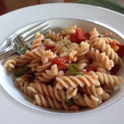 Five Ingredient Pasta Toss Recipe - Pasta is tossed with white beans, roasted diced tomatoes, fresh basil, and a garlic infused olive oil. Serve with crusty bread to soak up the sauce and any leftover garlic olive oil.