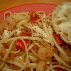 Shrimp and Feta Cheese Pasta Recipe - Shrimp is cooked in garlic and white wine, then tossed with pasta and feta in a fresh tomato sauce.