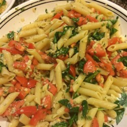 Tony's Summer Pasta Recipe - There's no need to cook this scrumptious sauce of fresh tomatoes stirred with mozzarella cheese, chopped basil, minced garlic, olive oil, salt and pepper. Just let the heady mix steep for a few minutes, toss with warm pasta, and cool before serving.