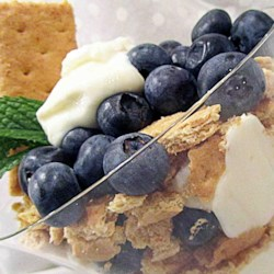 Lemon Blueberry Yogurt Parfait Recipe - Lemon yogurt, fresh blueberries, and honey graham crackers make an easy and delicious breakfast parfait.