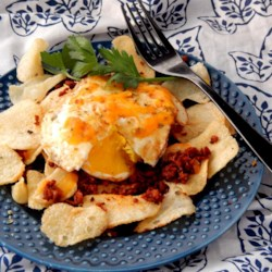 Breakfast Nachos! Recipe - Have nachos for breakfast with these breakfast nachos! Eggs, chorizo, and cheese over potato chips is a delicious and filling way to start the day.