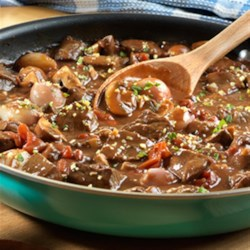 Braised Beef with Shallots and Mushrooms Recipe - This absolutely delectable, one-skillet dish slowly simmers for a few hours, resulting in fork-tender beef that will just about melt in your mouth.