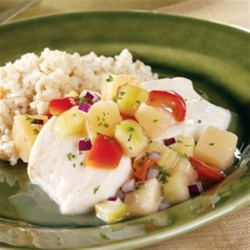 Poached Halibut with Chunky Pineapple Salsa Recipe - Poaching halibut is a quick and easy way to ensure good results...and when you serve the halibut with our sweet and savory salsa, the dish goes from really good to absolutely delicious!