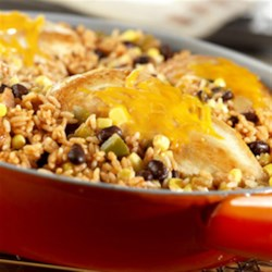 Santa Fe Chicken and Rice Recipe - This one-skillet dish features cheese topped chicken, rice, black beans and corn, all simmered in flavorful picante sauce. Your family will really enjoy this recipe!