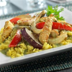 Thai Ginger Chicken with Yellow Jasmine Rice Recipe - Sautéed, boneless chicken breast strips, tender-crisp veggies and a ginger flavor-infused broth are combined with a pureed mixture of jalapeno peppers, coconut milk and fresh cilantro. Served with jasmine rice, this dish is bursting with fantastic flavors!