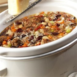 Slow Cooker Hearty Mixed Bean Stew with Sausage Recipe - Here's a hearty stew to feed a hungry crowd--it features a colorful array of beans simmering with sausage and chicken broth that slow cooks for hours, leaving you free to enjoy the day.