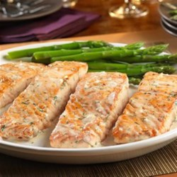 Salmon with Creamy Dill Sauce from Swanson(R) Recipe - Want to impress your guests? Try this delectable one skillet dish featuring salmon fillets bathed in a creamy sauce flavored with garlic, shallots, white wine and fresh dill. Simple yet elegant, it's sure to be a hit!