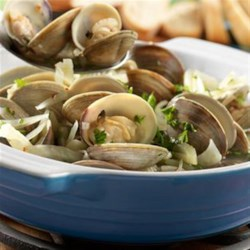 Steamed Clams from Swanson(R) Recipe - Clams are steamed in a savory sauce featuring seafood stock, white wine, garlic, fennel and red pepper flakes. Served with crusty bread for dipping, this is an amazing dish that can't be beat!