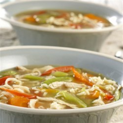 Ramen Chicken Noodle Soup Recipe - This tasteful chicken noodle soup with a zesty Asian flair features chicken broth, soy sauce, garlic, ginger and colorful vegetables, and it's ready in less than 30 minutes.