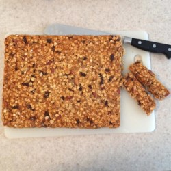 Sweet and Tart Vegan Granola Bar Recipe - Vegan granola bars are an easy, on-the-go snack loaded with dark chocolate, sunflower seeds, and dried cherries.