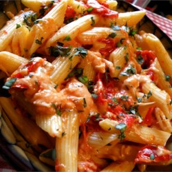 Tomato Basil Penne Pasta Recipe - Sweet grape tomatoes are simmered with garlic and then combined with three types of cheese - pepperjack, mozzarella, and Parmesan - to create this Mediterranean-style pasta dish.