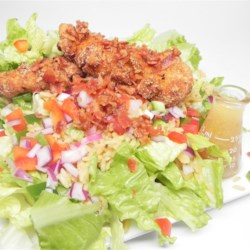 Shawna's Southern Fried Chicken Salad Recipe - What a great salad. Chopped breast meat is deep fried until golden and crispy and then combined with the other salad ingredients  - rice, bell peppers and onions  - and slathered with an incredible bacon-honey mustard  - vinegar dressing.