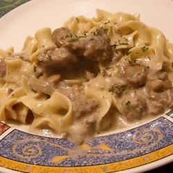 Easy Stroganoff Recipe - Whip up a warm and hearty stroganoff with ground beef, Worcestershire sauce, garlic and mushrooms in a rich sauce of milk, sour cream and cream of mushroom soup. Serve over hot egg noodles for a satisfying meal.