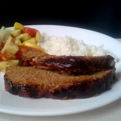 Tasty Turkey Meatloaf With Sauce Recipe - A simple turkey meatloaf is basted with a sweet and savory barbeque sauce is this easy weeknight meal idea.