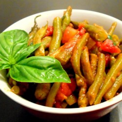 Aunt Kate's Green Beans in Tomatoes Recipe - Italian Flavor...easy to prepare. We are not a fan of green beans BUT cooked this way, simmered in a homemade tomato sauce, we are! Use fresh green beans.