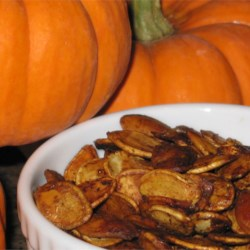 Spiced Pumpkin Seeds Recipe and Video - Make this snack by roasting fresh pumpkin seeds in margarine, Worcestershire sauce, and garlic salt.