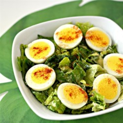Deviled Egg Salad Recipe - All the ingredients for sweetened deviled eggs are tossed with romaine lettuce in this quick and easy recipe for egg salad.